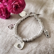 Sweetie Style Bracelet With Cutout Hand Or Footprint Charm